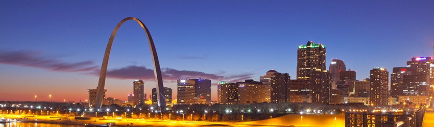 St. Louis skyline at twilight with arch.